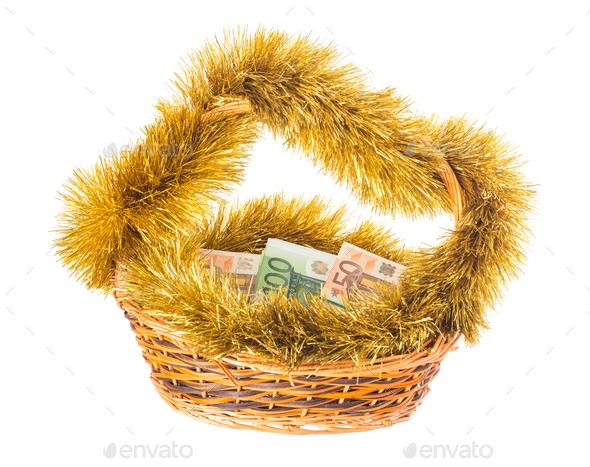 Wicker basket full of euro bills. - Stock Photo - Images