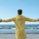 Successful Man Raising Hands Up and Looking at Sea Water - VideoHive Item for Sale