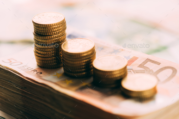 Euro coins on cash stack closeup - Stock Photo - Images