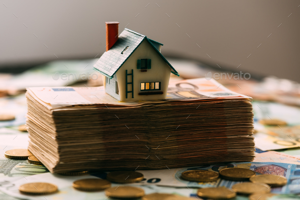 House model on cash stack closeup - Stock Photo - Images