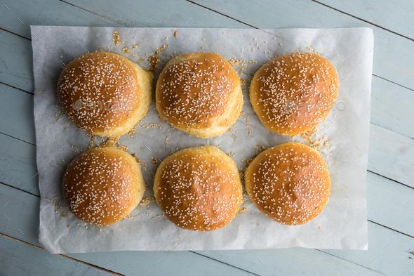 Homemade burger bun on parchment - Stock Photo - Images