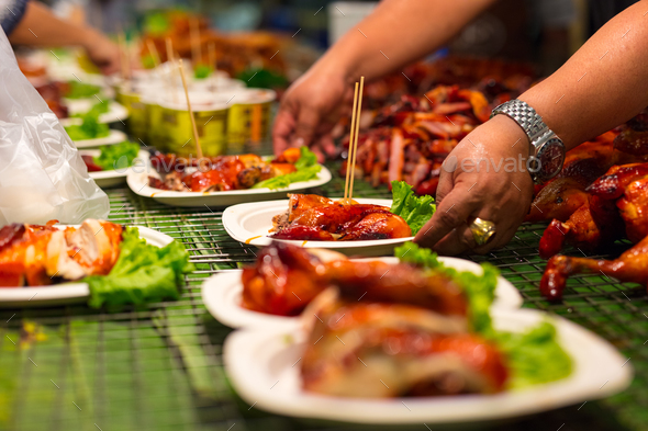 Vendor Serving Meat In Plates At Thai Street Food - Stock Photo - Images