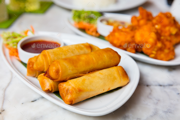 Spring Rolls And Fried Chicken Served In Plates - Stock Photo - Images