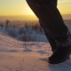 Lose up of Feet Walking in Snow Landscape - VideoHive Item for Sale