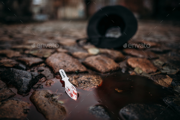 Bloodied murder weapon, crime concept - Stock Photo - Images