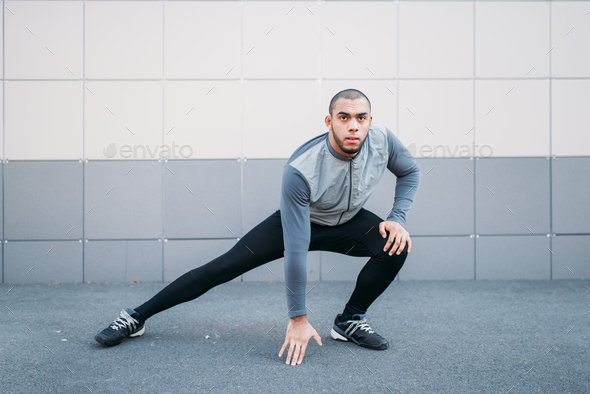 Athlete doing stretching exercise before running - Stock Photo - Images