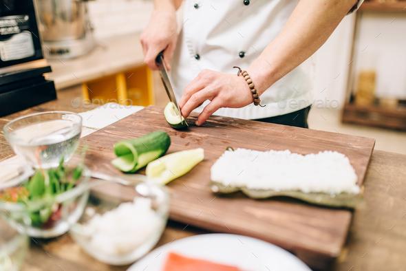 Sushi preparation process, japanese cuisine - Stock Photo - Images