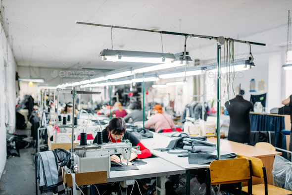 Workshop, production of clothing, sewing machine - Stock Photo - Images