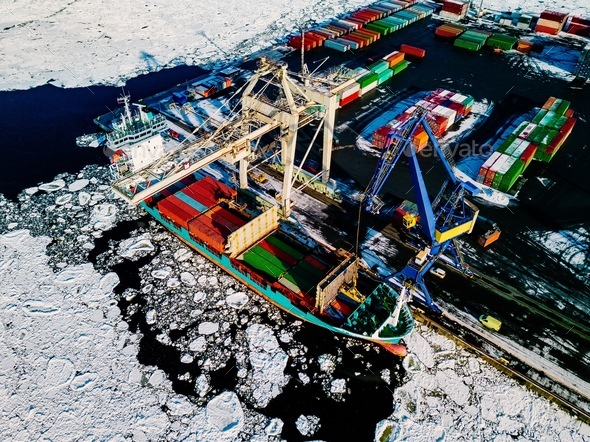 Industrial port with containers in winter, vessel loading - Stock Photo - Images