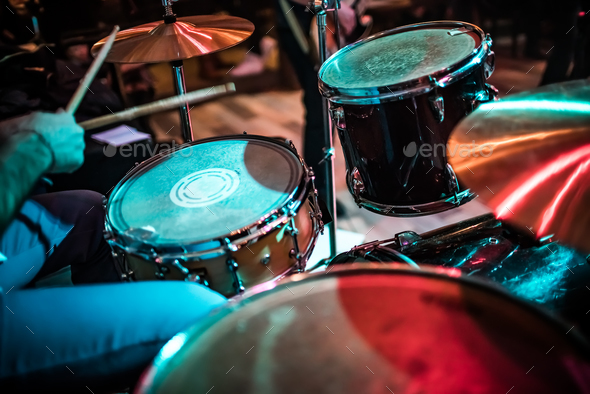 Drummer playing on drum set on stage. - Stock Photo - Images