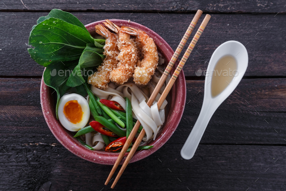 Bowl of delicious noodle soup with prawns - Stock Photo - Images