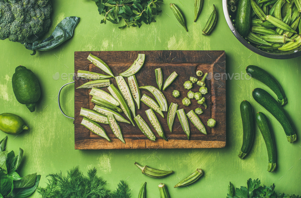Flay-lay of green vegetables and greens on wooden board - Stock Photo - Images