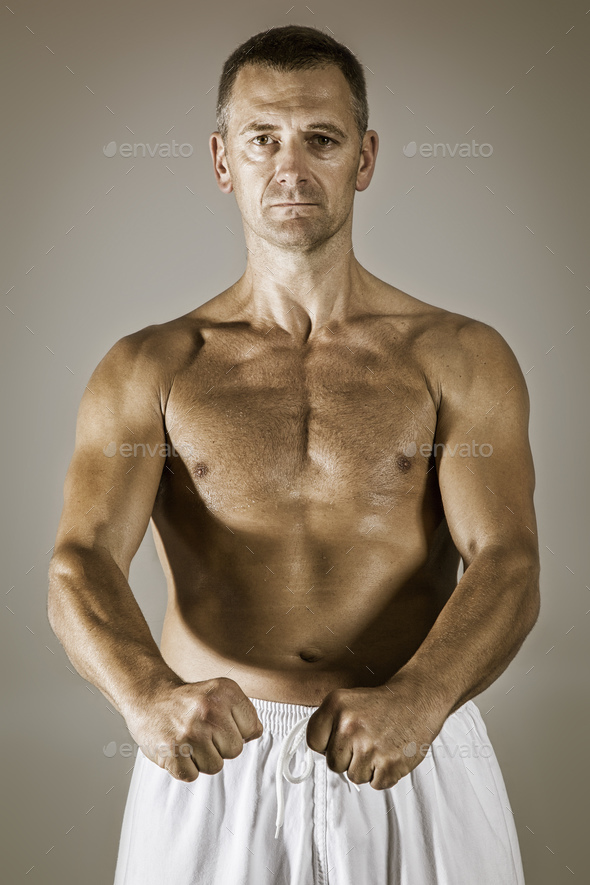 a middle age taekwondo fighter in basic position - Stock Photo - Images