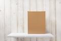 cardboard box on wooden shelf - PhotoDune Item for Sale