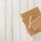 cardboard box on wooden background - PhotoDune Item for Sale
