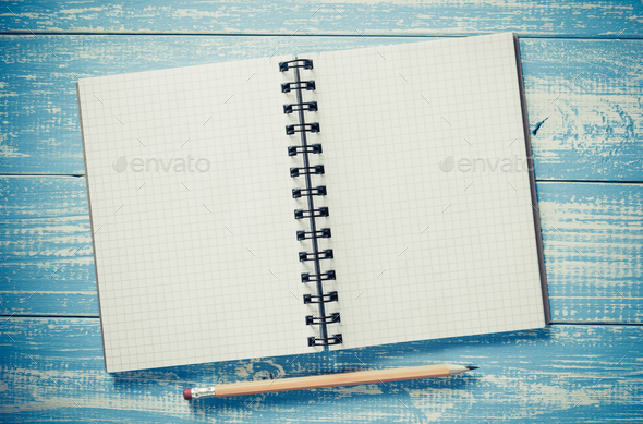 checked notebook on wood - Stock Photo - Images