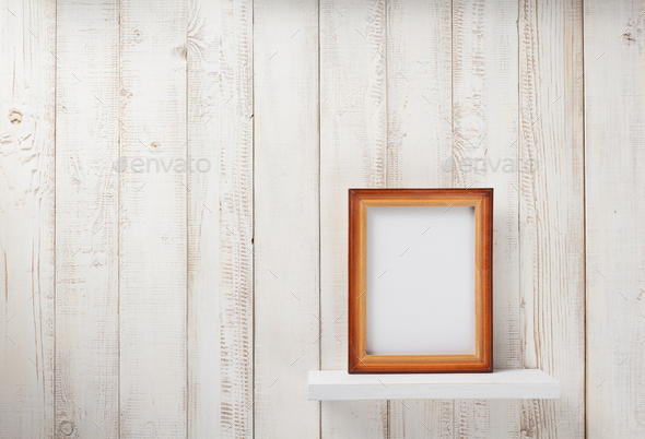 photo picture frame at wooden shel - Stock Photo - Images