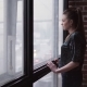 Sad Woman Goes to the Window and Looks at the City Street - VideoHive Item for Sale