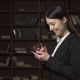 Successful Business Woman Using Smartphone in the Library - VideoHive Item for Sale