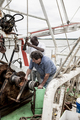 Commercial fishermen working on the deck of a shrimp boat - PhotoDune Item for Sale