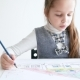 Little Girl Drawing a Picture on White Room - VideoHive Item for Sale