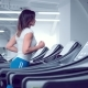 Adult Woman Runs on Treadmill at the Fitness Centre - VideoHive Item for Sale