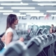 Adult Woman Runs on Treadmill at the Fitness Centre Attractive Sporty Girl Running on the Treadmil - VideoHive Item for Sale