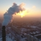 Aerial Shot of a Sky High Chimney with Slow White Smoke at Sunset in Winter - VideoHive Item for Sale