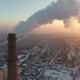 Aerial Shot of a Giant Chimney with Slow White Smoke at Sunset in Winter - VideoHive Item for Sale