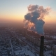 Aerial Shot of a Colossal Industrial Tower with Thick Smoke at Sunset in Winter - VideoHive Item for Sale