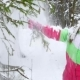 Girl Shakes the Snow From the Tree Branch in the Forest Happy Childhood. Winter Fun - VideoHive Item for Sale