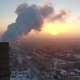 Aerial Shot of an Elevated Industrial Tower with Heavy Smoke at Sunset in Winter - VideoHive Item for Sale