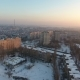 Aerial Shot of a City Block with Multistoreyed Buildings at Sunset in Winter - VideoHive Item for Sale