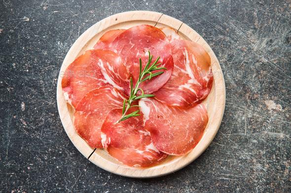 Sliced prosciutto crudo. - Stock Photo - Images