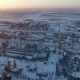 Aerial Shot of a City Infrastructure with Buildings, Roads and Parks in Winter - VideoHive Item for Sale