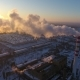 Aerial Shot of a Sky-high Hot Gas Tower with White Smoke at Sunset in Winter - VideoHive Item for Sale