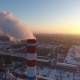 Aerial  of a Gigantic Cooling Tower with White Smoke at Sunset in Winter - VideoHive Item for Sale