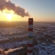 Aerial Shot of a Sky-high Boiler Tower with White Smoke at Sunset in Winter - VideoHive Item for Sale