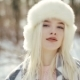 of a Cute Blonde Woman with Blue Eyes in a Winter Forest Poses on the Camera and Looks To the Side - VideoHive Item for Sale