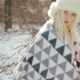 Attractive Blonde Woman with Blue Eyes in a Winter Forest Poses on the Camera - VideoHive Item for Sale