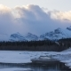 Clouds Flowing Over Snowy Mountain Peaks at Sunrise - VideoHive Item for Sale