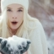 Attractive Young Blonde Woman Blowing Snow Flakes at Camera - VideoHive Item for Sale