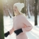 Young Pretty Blonde Girl in White Hat and Pink Sweater Running and Then Walking in the Winter Forest - VideoHive Item for Sale