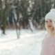 Young Pretty Blonde Girl in White Hat and Pink Sweater Walking in the Winter Forest - VideoHive Item for Sale