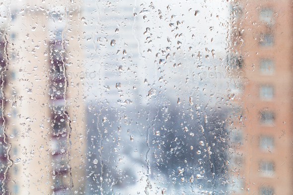 rain drops on home window glass in winter - Stock Photo - Images