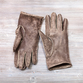 pair new hand-made gloves on table - PhotoDune Item for Sale