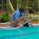 Man Assembles a Pool Vacuum Cleaner Providing Service and Maintenance of the Pool - VideoHive Item for Sale