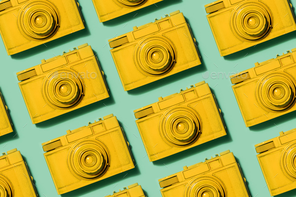 Retro yellow cameras on green background - Stock Photo - Images