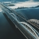 Cars and Train Moves on a Bridge over a Frozen River Aerial Drone Footage - VideoHive Item for Sale