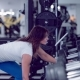 Fitness Woman Do Exercises on the Muscles of the Back with Dumbbell in Fitness Club. Athlete Doing - VideoHive Item for Sale